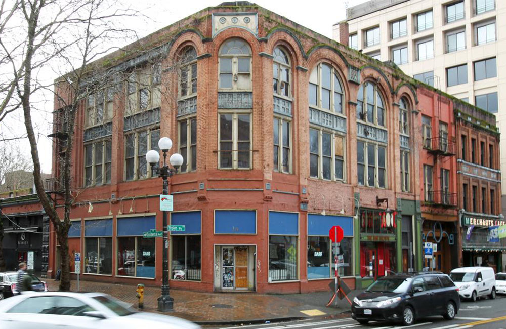 Unico acquires swath of Pioneer Square properties, including Merchant's Café